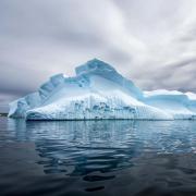 An iceberg floats in the Arctic Ocean