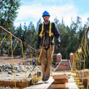 Jay Arehart crosses a footbridge under construction by Bridges to Prosperity.