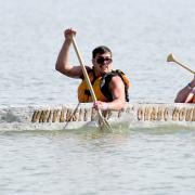 Alec Guevara and Mason Bell race CU Boulder's canoe at Boulder Reservoir (Photo courtesy the Daily Camera)