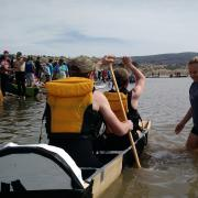 Students paddle the CU-Boulder concrete canoe