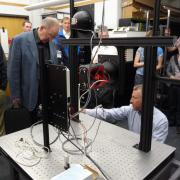Conference attendees tour CU lighting lab