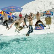 The winning team plunges into an icy pool on the course to celebrate their successful Slopesoakers event.