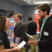 A student speaks with an employer at last year's career fair.