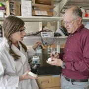Professor Karl Linden discusses a project with a student in his lab.