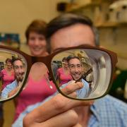 Bart Foster (front-left) and Wil Srubar (front-right) look through a pair of eyeglass lenses with graduate research assistants Sankar Ravichandran (back-left) and Elizabeth Delesky (back-right) standing behind them.