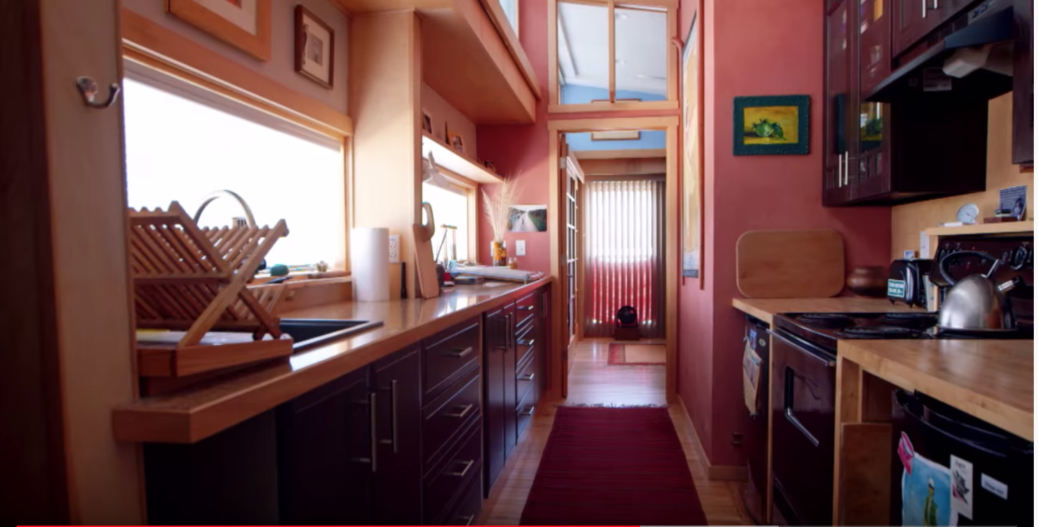 Interior of trailer wrap project showing the kitchen with wood cabinetry and trim.