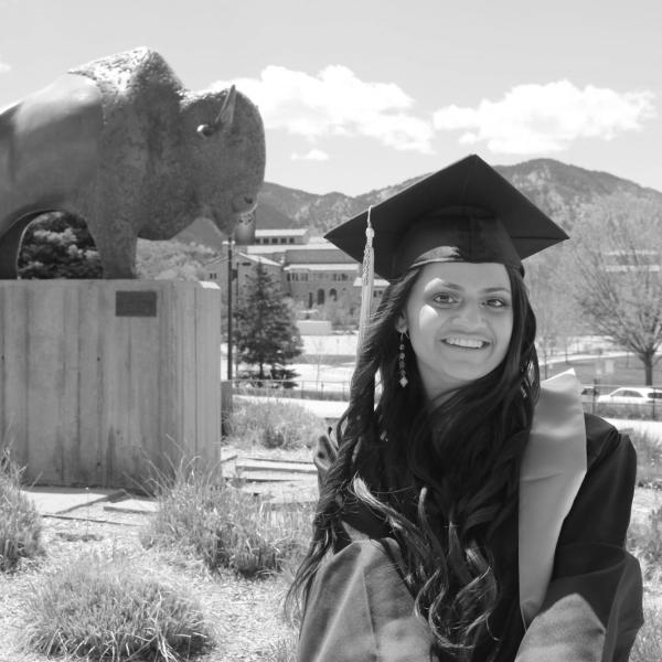 Ayushi Patel in front of a CU Boulder statue of a buff.