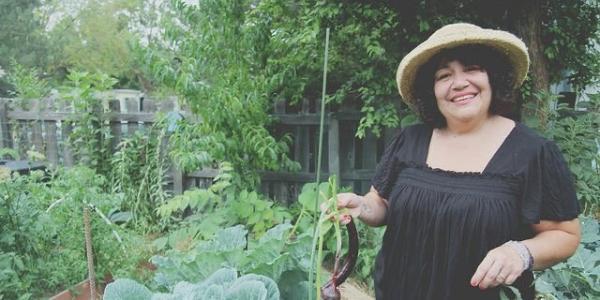 Isabel Sanchez in her garden at Mapleton Mobile Home Park