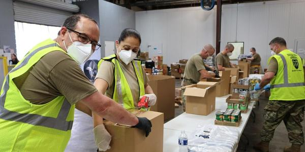People working at a food bank.