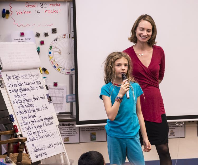 Mara Mintzer listens to a third grader present her ideas