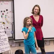 GUB Director Mara Mintzer listens to third grader share her ideas.