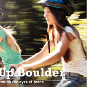 Two teens riding bikes.
