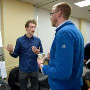 University of Colorado Boulder environmental design junior Josef Nelson, left, shares his ideas about the Sixth Avenue Plaza with Christ Church International Pastor Matthew Spencer on Wednesday.