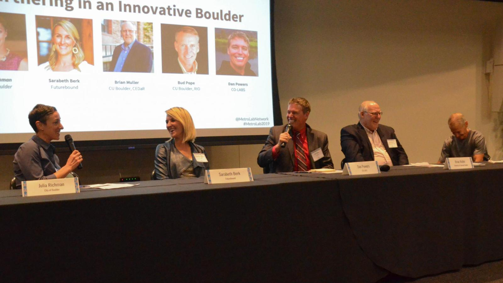 The panel reacts during a funny moment in the Partnering in an Innovative Boulder