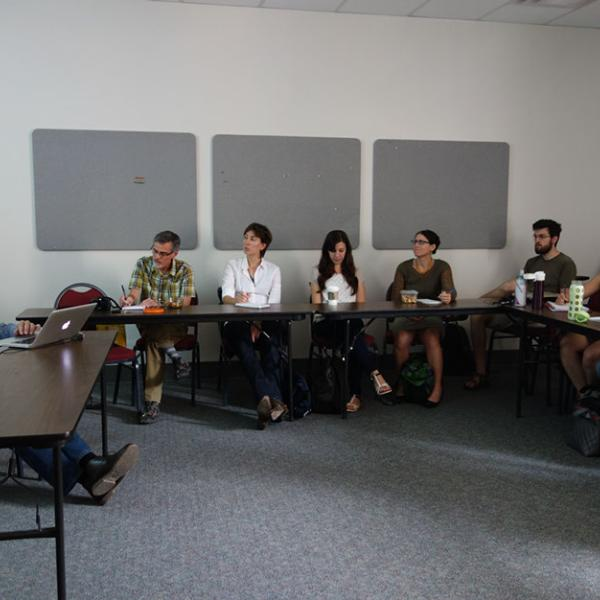 Science writing course with instructor Michael Kodas and a group of students at tables listening to instruction