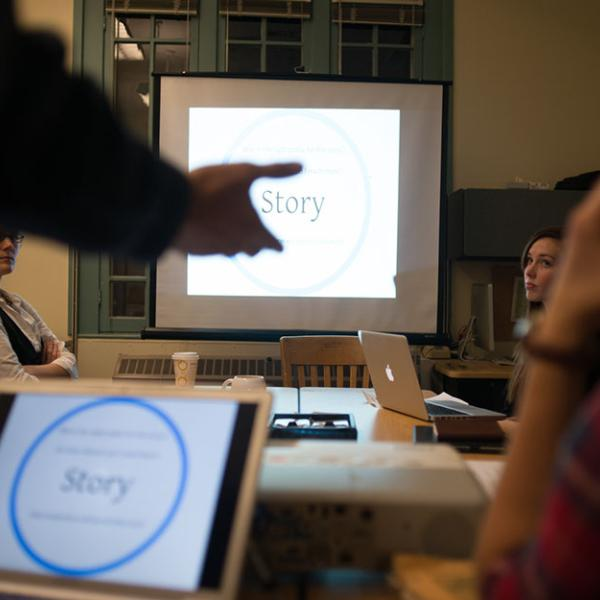 A laptop computer projects a diagram of science story components