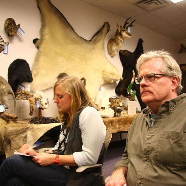 CEJ graduate student Kelsey Ray, left, and Scripps Fellow Scott Wallace visit the Wildlife Property Repository in Commerce City, CO.