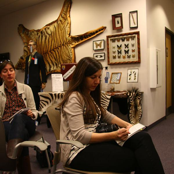 Scripps Fellows in Environmental Journalism Laura Krantz, left, and Sena Christian visit the National Wildlife Property Repository.