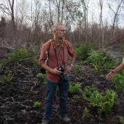 Michael Kodas (left) interviews an Indonesian environmental activist during one of his reporting trips to Sumatra and Borneo in 2014.