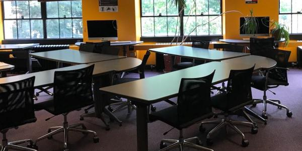 Tables and chairs in Hellems 152