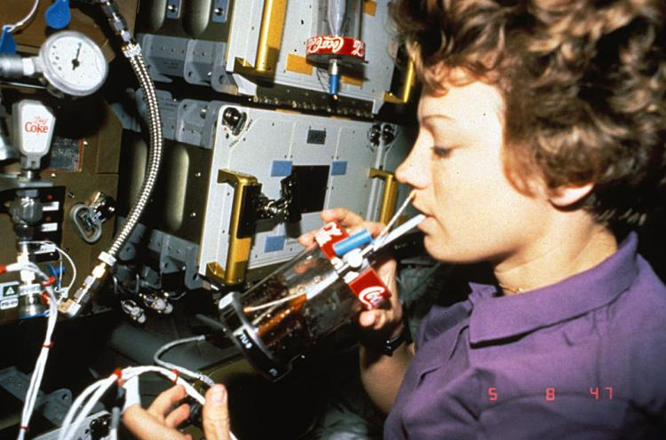 NASA astronaut Eileen Collins drinking Coke out of an FTU on STS-67