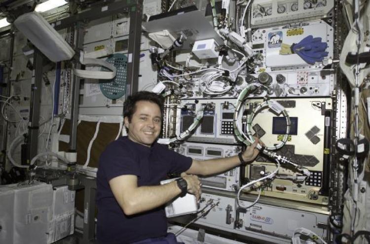 NASA astronaut Dan Bursch in front of CGBA installed into an EXPRESS rack