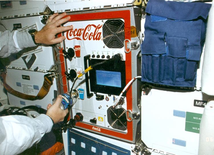 FGBA-2 being used by an astronaut to dispense Powerade on STS-77
