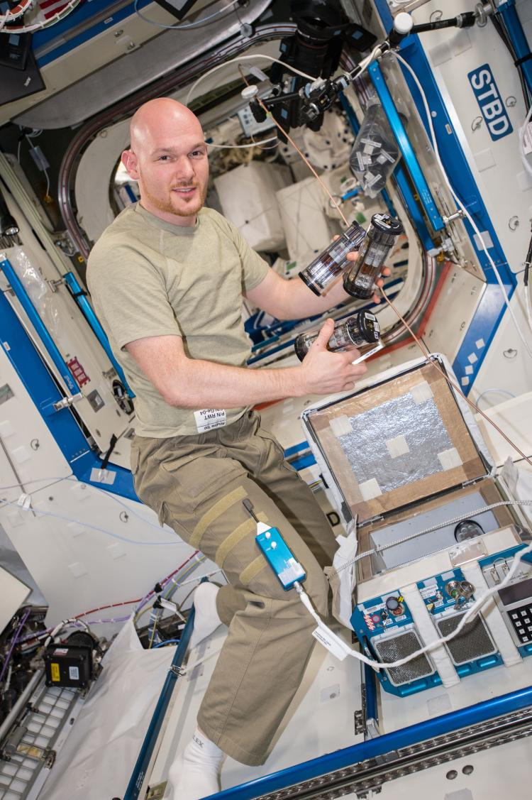 ESA astronaut Alexander Gerst juggling GAPs pulled out from CGBA on ISS