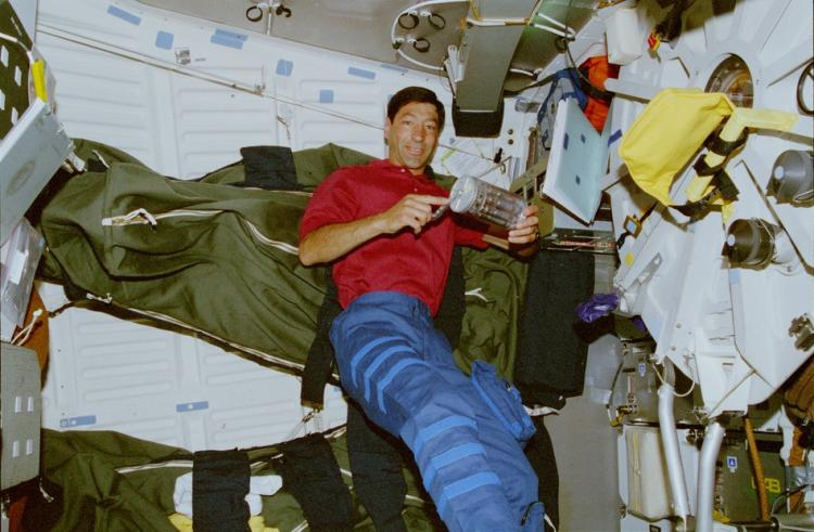 NASA astronaut Marco Runco activating a GAP on STS-77 during the IMMUNE-03 experiment