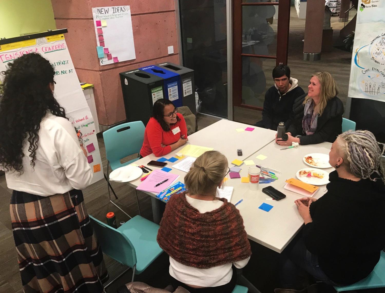 group of individuals talking at a table