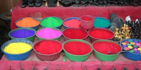Bowls of multi-colored Holi powder.