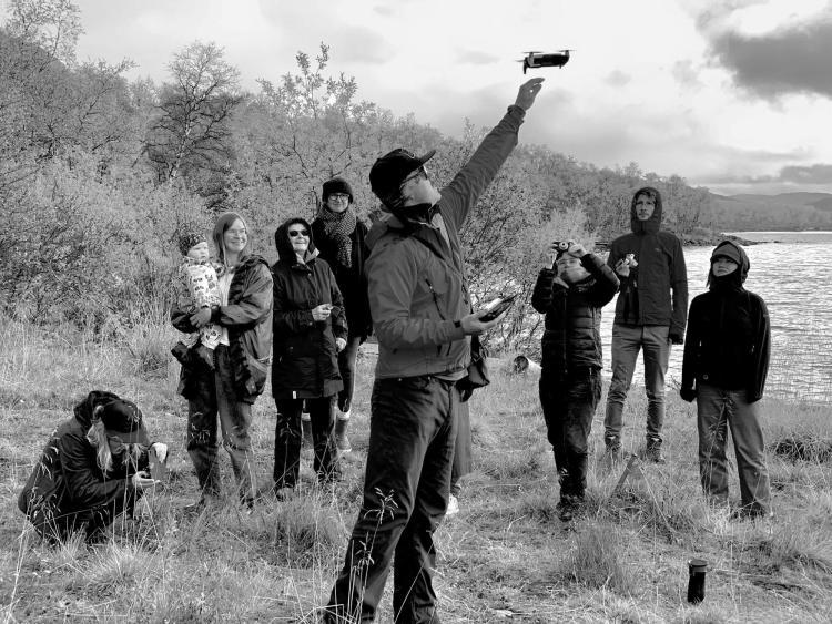 Bio Picture of film maker Adam Fish Launching a Drone