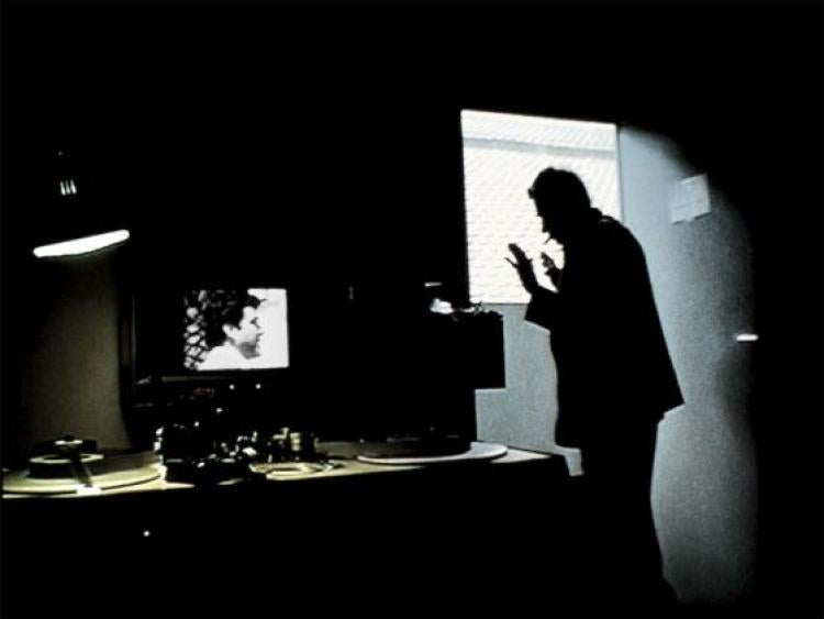 Man silhouetted in editing room. Still from Pedro Costa's Where Does Your Hidden Smile Lie? (2001).