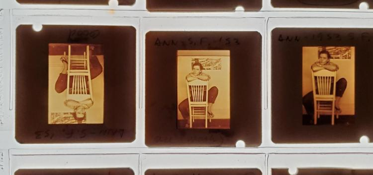 Three slides of a person sitting on a chair from Ann Roy's archive.