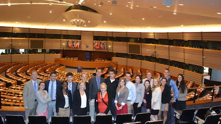 Students stand in the parliament chambers