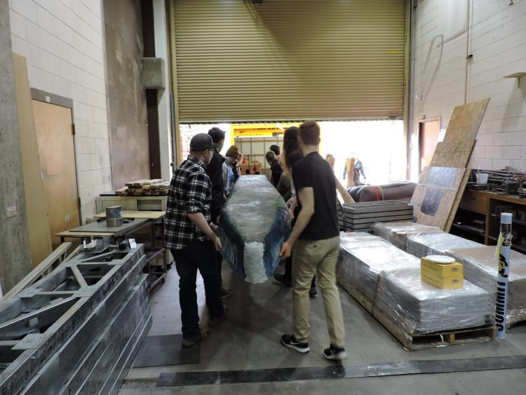 Students transporting the concrete canoe.