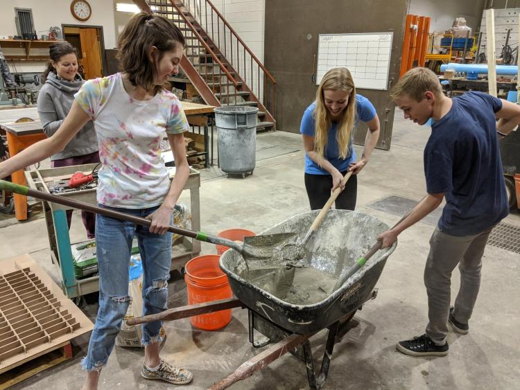Anna and friends work with concrete mix