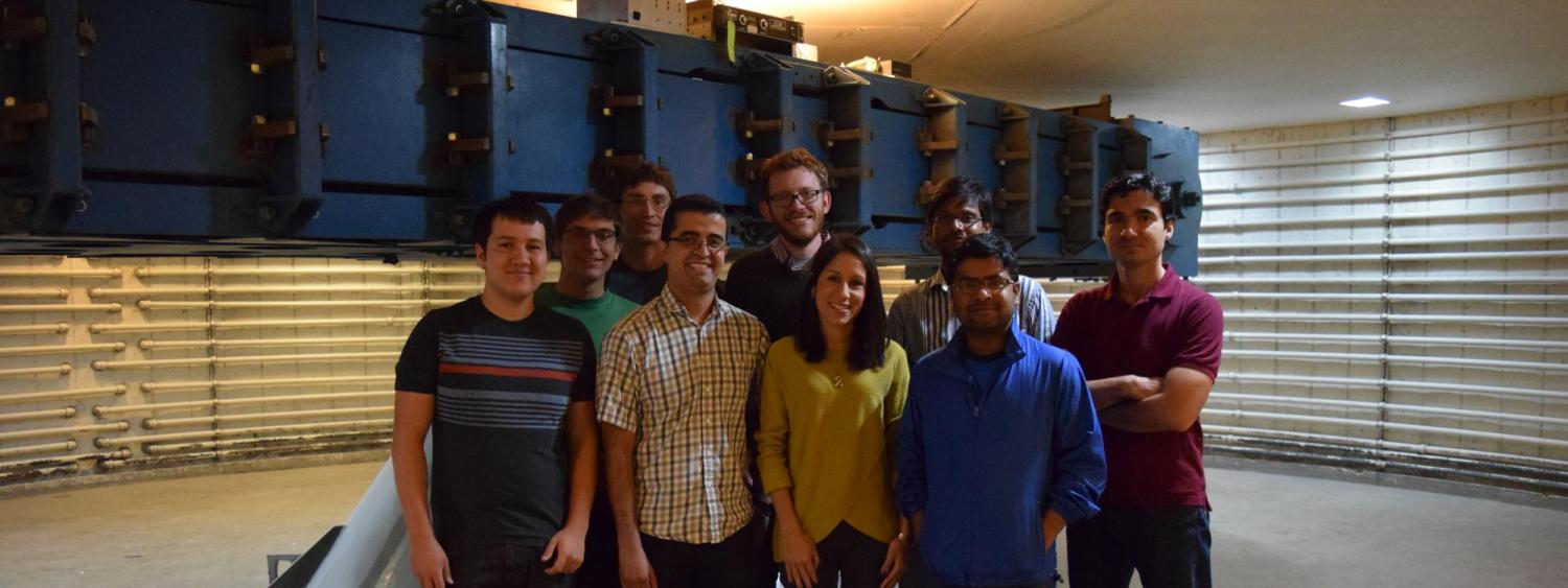 A group of students next to the 400 g-ton centrifuge