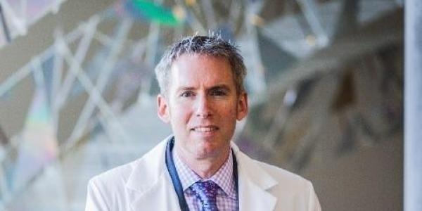 Dr. Ross Camidge
