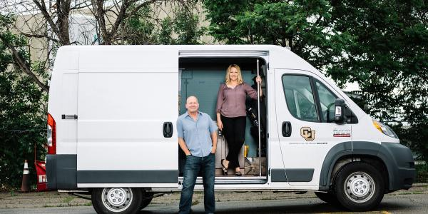 Kent Hutchison and Angela Bryan standing with mobile laboratory