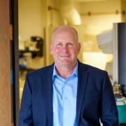 Kent Hutchison standing in door to lab