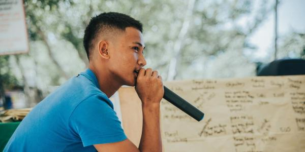 Young man holding microphone