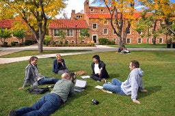 Students outside of Kittredge Hall in the fall