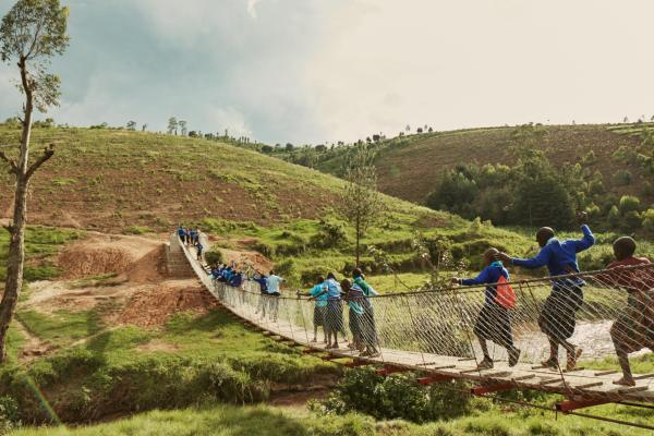 People crossing a rural footbridge