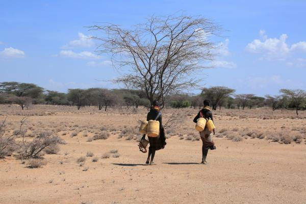 Women carrying water jugs