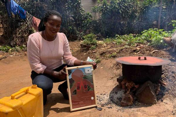 woman holding picture and cookstove