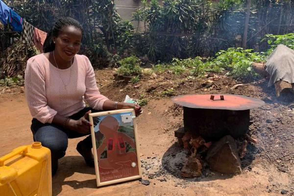 woman with painting and cookstove