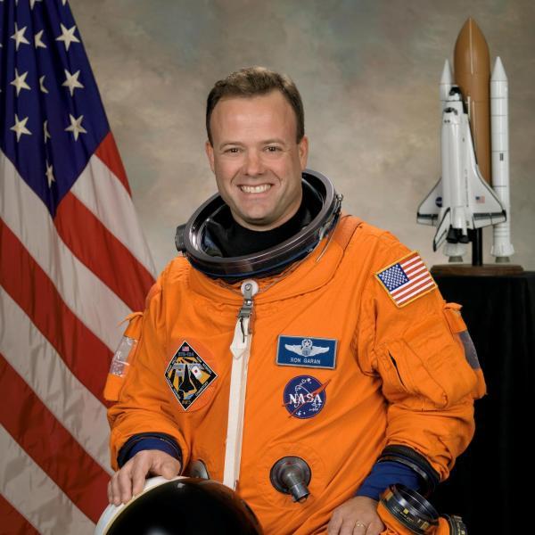 Official NASA portrait of Astronaut Ron Garan wearing a spacesuit