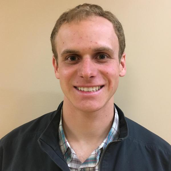 Headshot of Ryan Keliher, young man wearing blue jacket, short sandy blonde hair