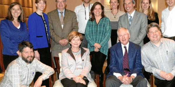 Alice and Mort Mortenson (seated) with staff and graduate students of the Mortenson Center